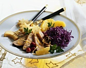Roast duck breast with red cabbage and potato cakes
