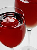Two glasses of red wine with rippled surface