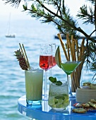 Various cocktails against a Mediterranean backdrop