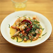 Shrimp salad with chili pepper and strips of basil