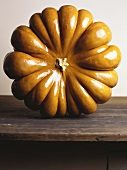 Giant pumpkin (standing up) on wooden table