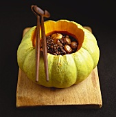 Pumpkin & lentil stew with chestnuts in hollowed-out pumpkin