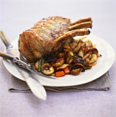 Stuffed roast pork with chestnuts, carrots and bay leaf