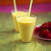 Mango milkshake in two glasses