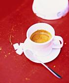 Espresso in white cup; sugar cubes