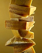 Chain of pieces of Parmesan at various stages of maturity
