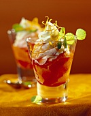Yoghurt cream on Campari oranges in glass