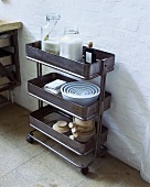 Crockery and food on trolley in industrial kitchen
