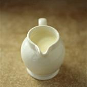 Cream in small white jug