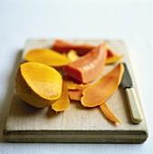 Mango, cut up on chopping board