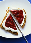 Wholemeal bread with soft cheese and berry puree