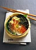 Chirashi-sushi: sushi rice with shrimps and trout caviar