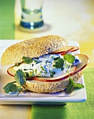 Sesame bagel with herb quark and apple slices