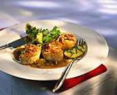 Pork medallions in spicy sauce with bacon and capers