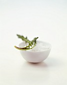Coarse salt in small bowl, rocket on top