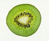 Slice of kiwi fruit on white background