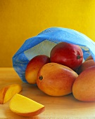 Fresh mangos in blue net
