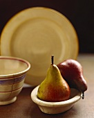 Two pears in wooden bowl