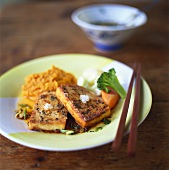 Fried smoked sesame tofu with red lentil puree