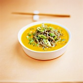 Carrot soup with soba noodles, sesame and spring onions