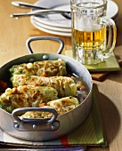 White cabbage roulades with mince filling; beer