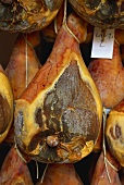 Various hams from Italy, hanging in shop