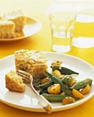Okra salad with yellow cherry tomatoes; corn bread