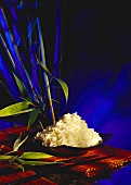 Bowl of rice and fresh bamboo