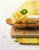 Bread with Alpine cheese on wooden board
