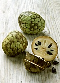 Cherimoyas (Annona cherimola) one with pieces cut off