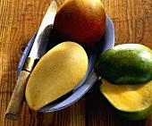 Mangos (Mangifera indica) whole and cut up