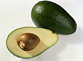 Avocado, variety: Fuerte (Persea americana) halved, with stone