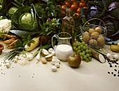 Still life: vegetables, fruit, olive oil, eggs, milk etc.