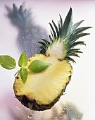 Halved pineapple with pineapple sage