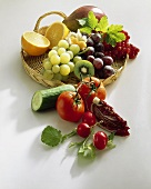 Fresh fruit on wicker tray, vegetables in front