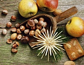 Christmassy still life with apples, nuts and gingerbread