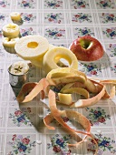 Apple, partly peeled and cut into rings