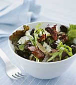 Salad leaves with olives, blue cheese and walnuts
