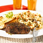 Grilled beef medallion with pasta salad