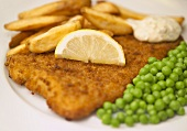 Breaded plaice with fries, peas and tartare sauce