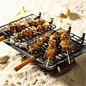 Several meat kebabs on barbecue