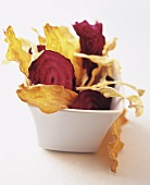 Vegetable crisps in white bowl