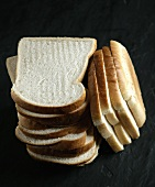 Slices of white bread, in a pile