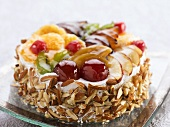Fruit torte with chopped almonds