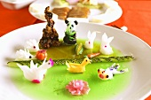 Cold cucumber soup with food carvings (Asia)