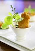 Fried rabbit in a small bowl