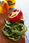 Red, green and yellow peppers, sliced