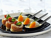 Salmon snacks and fish dumplings with caviar