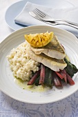 Sea bass fillets with red chard and risotto