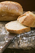 White tin loaf, partly sliced